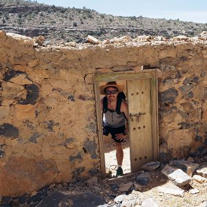 Steve exploring an abandoned village ruins in the Jebal Akhdar Mountains