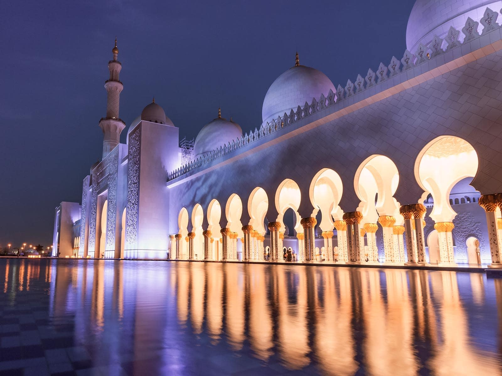 Arches lit up in blue at the Sheikh Zayed Grand Mosque Abu Dhabi