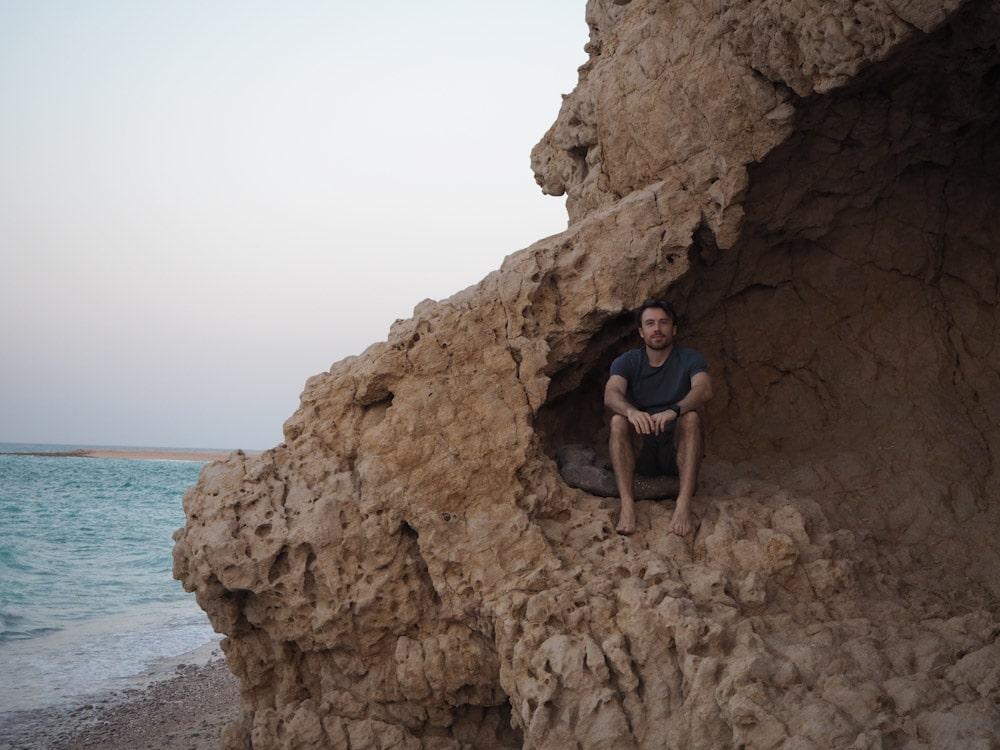 Steve sitting on rocks at Wadi Shab Resort